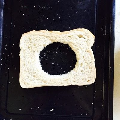 How to cook a breakfast sandwich. Rosemary Honey Mayo Egg In A Hole Toast - Step 1