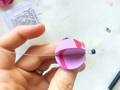 How to make a set of paper earrings. Baubble Origami Earrings - Step 7