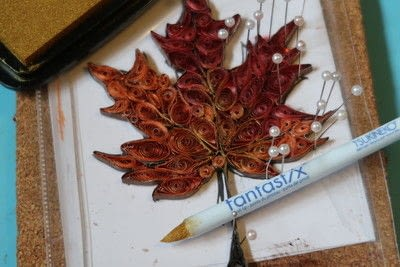 How to fold a piece of quilled art. Quilled Multi Color Foiled Maple Leaf - Step 5