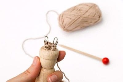 How to stitch a knit or crochet coaster. Winter Coaster With A Knitting Doll - Step 1