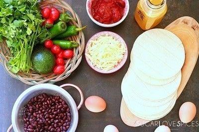 How to cook Huevos Rancheros. Huevos Rancheros With Black Bean And Avocado - Step 1