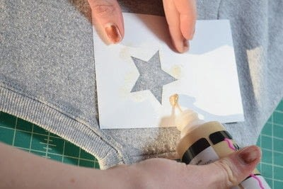 How to embellish an embellished sweater. Diy Pearl Embellished Sweater With Fabric Paint Stars - Step 4
