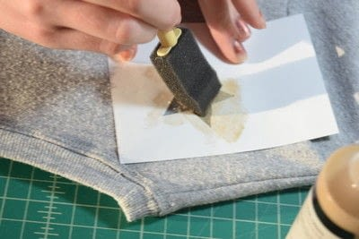 How to embellish an embellished sweater. Diy Pearl Embellished Sweater With Fabric Paint Stars - Step 5