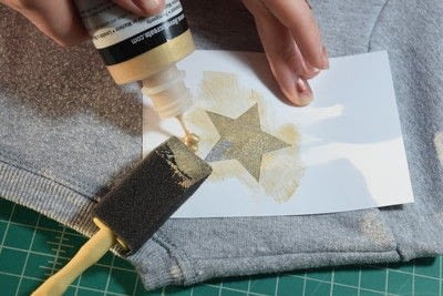 How to embellish an embellished sweater. Diy Pearl Embellished Sweater With Fabric Paint Stars - Step 6
