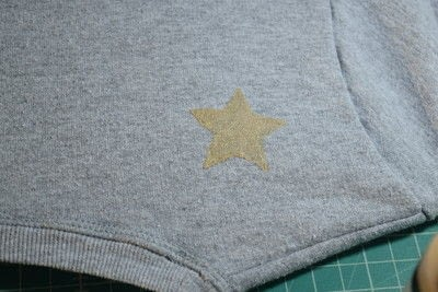 How to embellish an embellished sweater. Diy Pearl Embellished Sweater With Fabric Paint Stars - Step 7