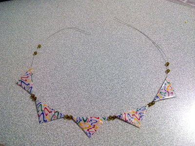 How to make a bunting necklace. Chewing Gum Wrapper Bunting Necklace - Step 5