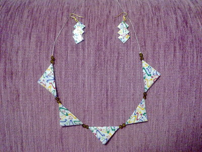How to make a bunting necklace. Chewing Gum Wrapper Bunting Necklace - Step 7