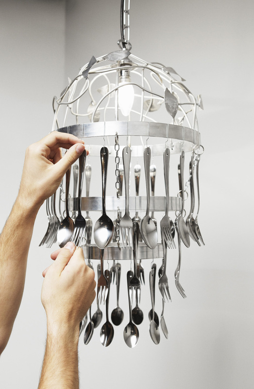 Kitchen cutlery chandelier how to make a recycled light for Chandelier craft ideas
