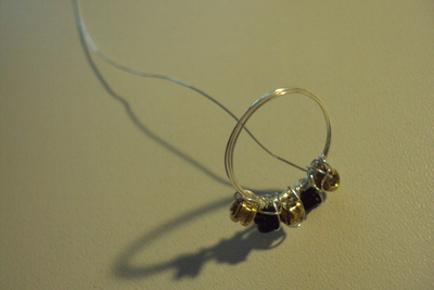 How to make a wire ring. Sparkling Rings From Ball End Strings. - Step 7