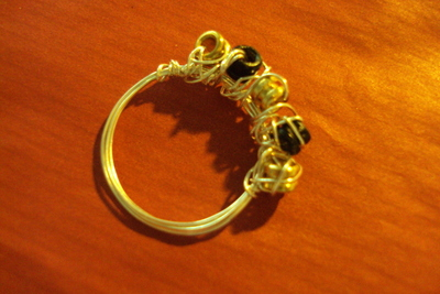 How to make a wire ring. Sparkling Rings From Ball End Strings. - Step 8