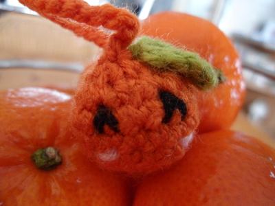 How to stitch a knit or crochet keyring. Orange Amigurumi Phone Charm - Step 4