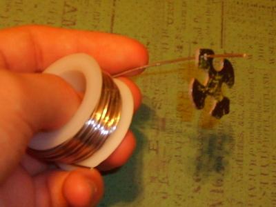 How to recycle a puzzle piece bracelet. Puzzle Piece Bracelet - Step 4