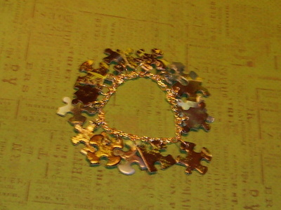 How to recycle a puzzle piece bracelet. Puzzle Piece Bracelet - Step 9