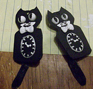 How to sculpt a set of clay animal earrings. Kit Kat Clock Earrings - Step 14