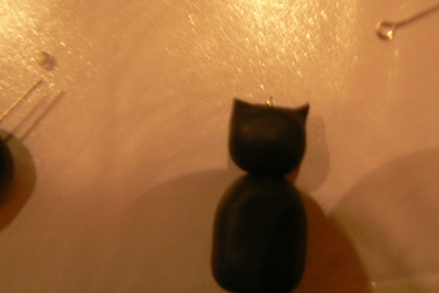 How to sculpt a set of clay animal earrings. Kit Cat Clock Inspired Jewellery Set - Step 4