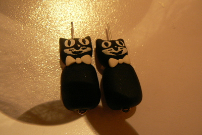 How to sculpt a set of clay animal earrings. Kit Cat Clock Inspired Jewellery Set - Step 9