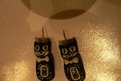 How to sculpt a set of clay animal earrings. Kit Cat Clock Inspired Jewellery Set - Step 10