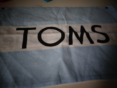 How to make a recycled pouch. Toms Flag Into Wallet - Step 1