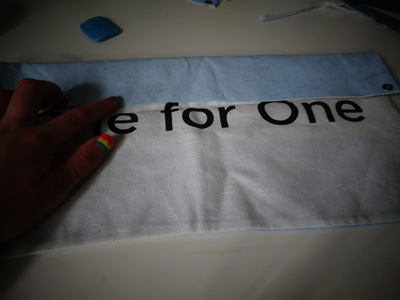 How to make a recycled pouch. Toms Flag Into Wallet - Step 2