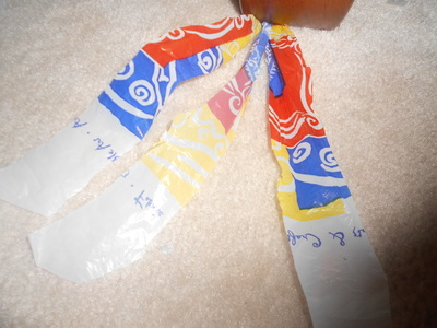 How to make a recycled bracelet. Recycled Bag Bracelets - Step 3