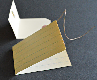 How to make a recycled book. Hang Tag Notebooks - Step 8