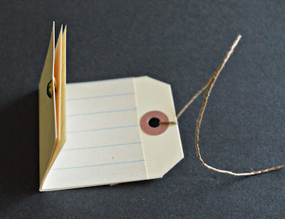 How to make a recycled book. Hang Tag Notebooks - Step 9