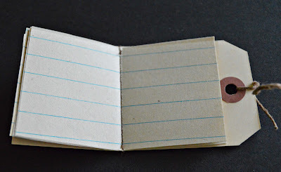 How to make a recycled book. Hang Tag Notebooks - Step 10