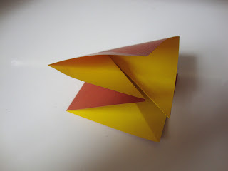 How to fold an origami shape. Origami Bows - Step 4