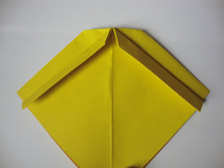 How to fold an origami shape. Origami Bows - Step 14