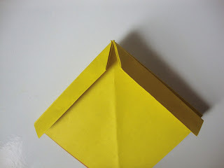How to fold an origami shape. Origami Bows - Step 15