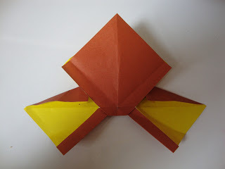 How to fold an origami shape. Origami Bows - Step 23