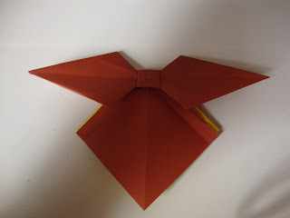 How to fold an origami shape. Origami Bows - Step 25
