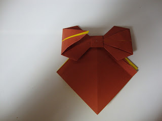 How to fold an origami shape. Origami Bows - Step 26