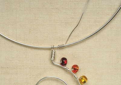 How to make a wire necklace. Rainbow Necklace - Step 7