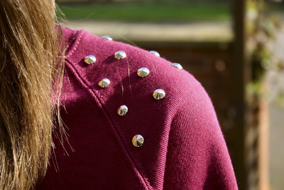 How to embellish an embellished sweater. Diy Studded Sweater - Step 4