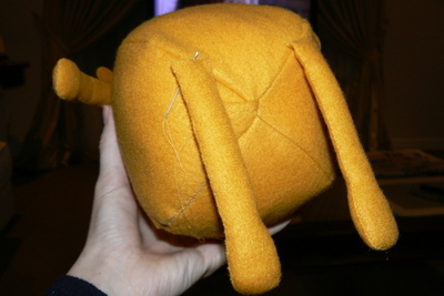 How to make a dog plushie. Adventure Time Jake Plush - Step 19
