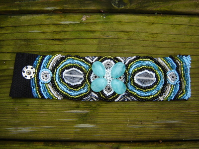 How to make a fabric cuff. Bead Embroidery Bracelet In Green, Blue, White And Black - Step 6