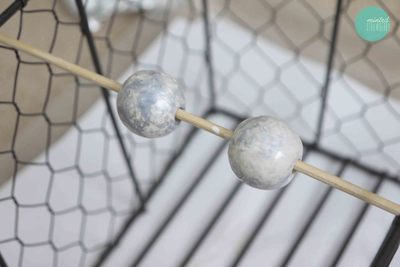 How to make a pair of chandelier earrings. Diy Gilded Ball Drop Earrings - Step 3
