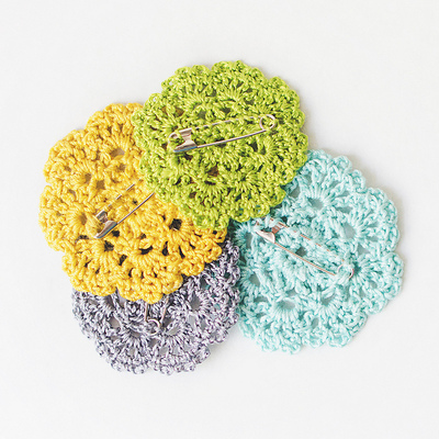 How to stitch a knit or crochet brooch. Crochet Doily Brooch - Step 2