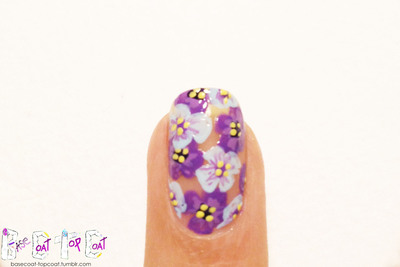 How to paint patterned nail art. Layered Purple Flowers - Step 12