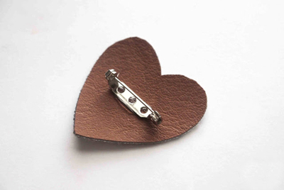 How to embellish a bejewelled brooch. Hand Crafted Jewelry Diy Brooch Out Of Leather And Round Studs - Step 4
