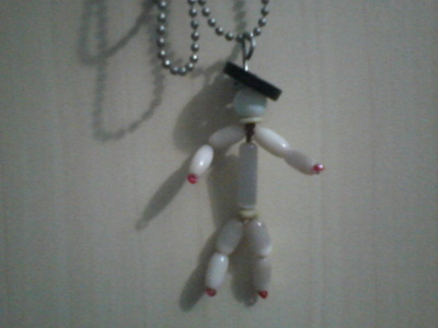 How to make a pendant necklace. Beaded Man - Step 4