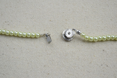 How to make a pearl necklace. Ivory Pearls Necklace Adorned By Flower And Turquoise  - Step 6